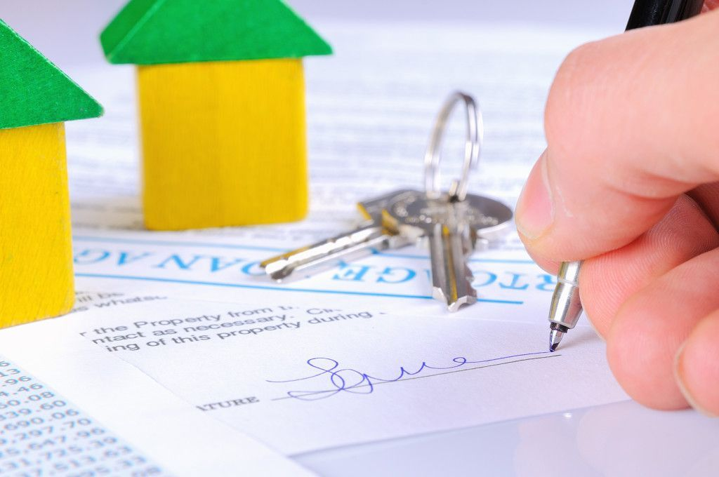 Signing the mortgage contract to delivery of keys with wooden ho