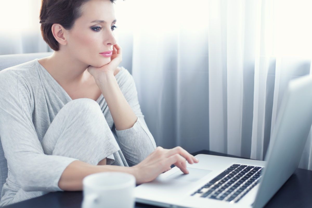 Young Woman sitting in front of a computer in the morning, home office